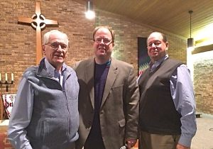 Holocaust suvivor, Eric Blaustein, Pastor Jay Moses, and Rabbi Steve Bob gather together after Eric shared his personal story of surviving the Holocaust with members of the community.