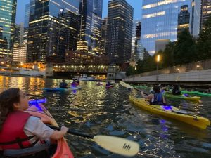 """Lighthouse """"lights up the city"""" kayaking on the Chicago River!"""