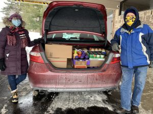 """February Food Drive a huge success! Due to the weahter, the """"Little Red Truck"""" took a day off, but we were able to fill a car (trunk, back seat and front seat) with PB&J and other canned goods plus the back of a SUV with diapers. Thanks for your support."""